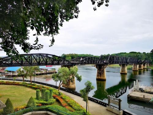 The railroad bridge over the Mae Klong River (or the Kwai Yai River) in Kanchanaburi Province, Thailand. The span of this bridge is composed of nine curved-truss segments (originals dating back to WWII) and two angular-truss segments (replacements (under war reparations) from Japan after 1945).