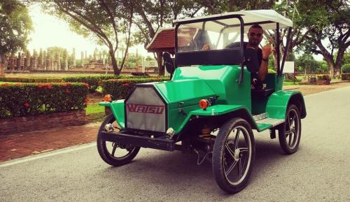 Driving an electric car around Sukhothai historical park.