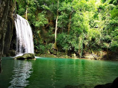 beautiful waterfalls in Thailand. Located in the Tenasserim Hills in Kanchanaburi Province, some 200 km northwest of Bangkok, Erawan has seven separate tiers and is part of a national park of the same name.